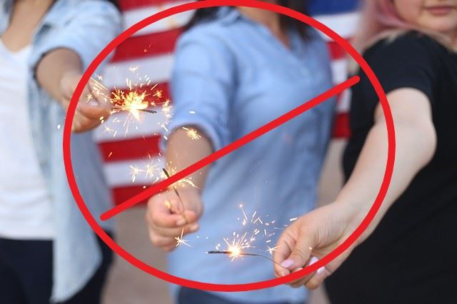 people holding sparklers with a red circle and line through picture